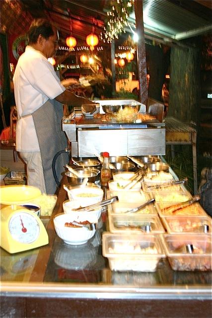 Buffet of various meats, veggies, condiments & sauces